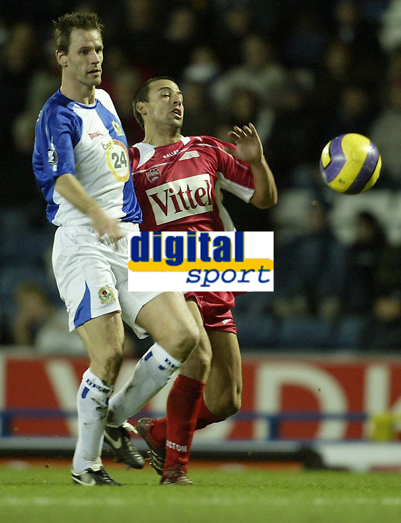 Photo: Aidan Ellis.<br /> Blackburn Rovers v AS Nancy. UEFA Cup. 13/12/2006.<br /> Rovers Andre Ooijer (L) battles with Nancy's Pascal Berenguer