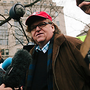 Washington DC, USA, 20 January, 2017. Filmmaker Michael Moore talks with press protesting the inauguration of Donald Trump.