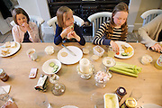 In the Bakers' kitchen, Pickwell Manor, Georgeham, North Devon, UK. From left to right: Liza Baker (9), Millie-grace Elliott (8), Molly Elliott (10).<br /> CREDIT: Vanessa Berberian for The Wall Street Journal<br /> HOUSESHARE