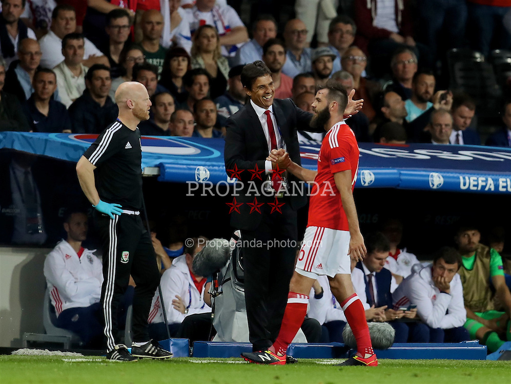 TOULOUSE, FRANCE - Monday, June 20, 2016: Wales' Joe Ledley shakes hands with manager Chris Coleman as he is substituted during the 3-0 victory over Russia during the final Group B UEFA Euro 2016 Championship match at Stadium de Toulouse. (Pic by David Rawcliffe/Propaganda)