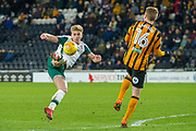 Brad Potts of Barnsley bicycle kick shot at goal during the EFL Sky Bet Championship match between Hull City and Barnsley at the KCOM Stadium, Kingston upon Hull, England on 27 February 2018. Picture by Craig Zadoroznyj.