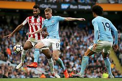 Kevin De Bruyne of Manchester City challenges Eric Maxim Choupo Moting of Stoke City - Mandatory by-line: Matt McNulty/JMP - 14/10/2017 - FOOTBALL - Etihad Stadium - Manchester, England - Manchester City v Stoke City - Premier League