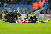 Brentford attacker Neal Maupay (9) shortly before being stretchered off the pich during the EFL Sky Bet Championship match between Queens Park Rangers and Brentford at the Loftus Road Stadium, London, England on 10 November 2018.