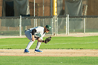 KELOWNA, BC - JULY 24: Third baseman, Nick Israel #10 of the Yakima Valley Pippins, scoops a ground ball against the the Kelowna Falcons  at Elks Stadium on July 24, 2019 in Kelowna, Canada. (Photo by Marissa Baecker/Shoot the Breeze)