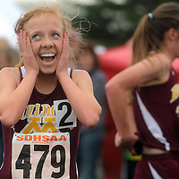 Madison's Emily Hawkes looks toward the scoreboard after winning the girls 3200 meter run during the 2013 Class A SDHSAA State Track and Field Meet on Friday, May 24, 2013.