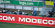 Photographers shoots images behind advertises during T-Mobile ExtraLeague soccer match between Legia Warsaw and Podbeskidzie Bielsko Biala in Warsaw, Poland.<br /> <br /> Poland, Warsaw, March 01, 2015<br /> <br /> Picture also available in RAW (NEF) or TIFF format on special request.<br /> <br /> For editorial use only. Any commercial or promotional use requires permission.<br /> <br /> Mandatory credit:<br /> Photo by © Adam Nurkiewicz / Mediasport