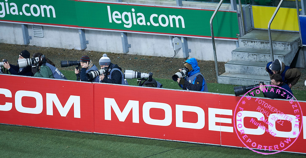 Photographers shoots images behind advertises during T-Mobile ExtraLeague soccer match between Legia Warsaw and Podbeskidzie Bielsko Biala in Warsaw, Poland.<br /> <br /> Poland, Warsaw, March 01, 2015<br /> <br /> Picture also available in RAW (NEF) or TIFF format on special request.<br /> <br /> For editorial use only. Any commercial or promotional use requires permission.<br /> <br /> Mandatory credit:<br /> Photo by &copy; Adam Nurkiewicz / Mediasport