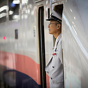 TOKYO, JAPAN - JULY 13 : A JR conductor of a bullet train is seen at Tokyo Station on Wednesday, July 13, 2016, Tokyo, Japan.<br />   <br /> Photo: Richard Atrero de Guzman