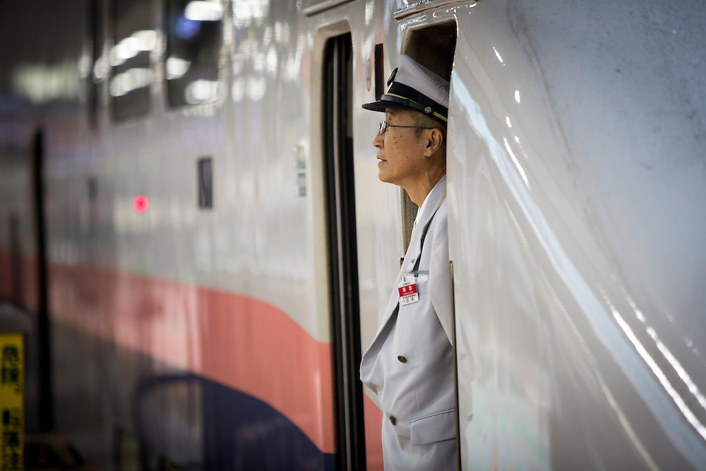 TOKYO, JAPAN - JULY 13 : A JR conductor of a bullet train is seen at Tokyo Station on Wednesday, July 13, 2016, Tokyo, Japan.<br />   <br /> Photo: Richard Atrero de Guzman