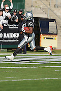 OAKLAND, CA - DECEMBER 19:  Wide receiver Jerry Porter #84 (caught 8 passes for 148 yards and 3 touchdowns) of the Oakland Raiders catches a 32 yard pass for a 14-7 Raiders lead in the first quarter against the Tennessee Titans at Network Associates Coliseum on December 19, 2004 in Oakland, California. The Raiders defeated the Titans 40-35. ©Paul Anthony Spinelli *** Local Caption *** Jerry Porter