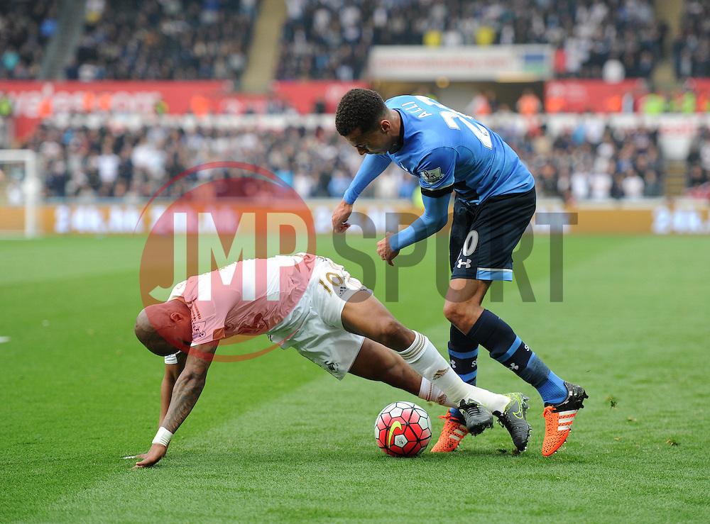 Dele Alli of Tottenham Hotspur fouls Andre Ayew of Swansea City - Mandatory byline: Alex James/JMP - 07966 386802 - 04/10/2015 - FOOTBALL - Liberty stadium - Swansea, England - Swansea City  v Tottenham hotspur - Barclays Premier League