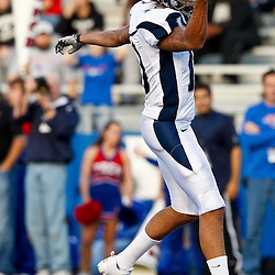 December 4, 2010; Ruston, LA, USA;  Nevada Wolf Pack quarterback Colin Kaepernick (10) celebrates as he scores a touchdown during the second half against the Louisiana Tech Bulldogs at Joe Aillet Stadium.  Nevada defeated Louisiana Tech 35-17. Mandatory Credit: Derick E. Hingle
