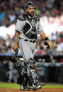 Jun. 18 2011; Phoenix, AZ, USA; Chicago White Sox catcher Ramon Castro (27) reacts on the field while playing against the Arizona Diamondbacks at Chase Field. The White Sox defeated the Diamondbacks 6-2.  Mandatory Credit: Jennifer Stewart-US PRESSWIRE..