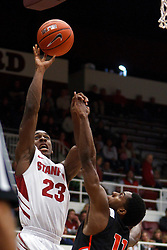 Nov 28, 2011; Stanford CA, USA;  Stanford Cardinal guard Gabriel Harris (23) shoots over Pacific Tigers guard Lorenzo McCloud (11) during the second half at Maples Pavilion. Stanford defeated Pacific 79-37. Mandatory Credit: Jason O. Watson-US PRESSWIRE