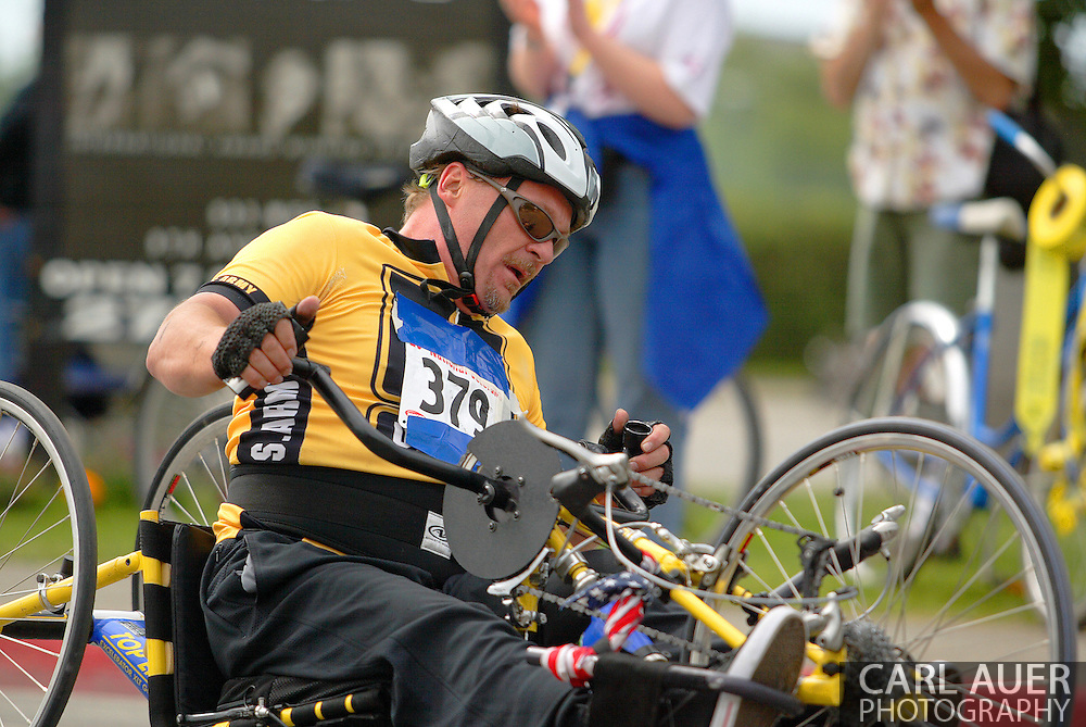 July 4th, 2006:  Anchorage, Alaska - William Smith (379), a Army veteran from Modesto, California, flies through turn one of the 5k handcycle event at the 26th National Veterans Wheelchair Games..