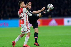 Sergiño Dest #28 of Ajax and Oussama Idrissi #11 of AZ Alkmaar in action during the Dutch Eredivisie match round 25 between Ajax Amsterdam and AZ Alkmaar at the Johan Cruijff Arena on March 01, 2020 in Amsterdam, Netherlands