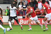 Fulham forward Aboubakar Kamara (47) and  Barnsley midfielder Alex Mowatt (27) during the EFL Sky Bet Championship match between Barnsley and Fulham at Oakwell, Barnsley, England on 3 August 2019.