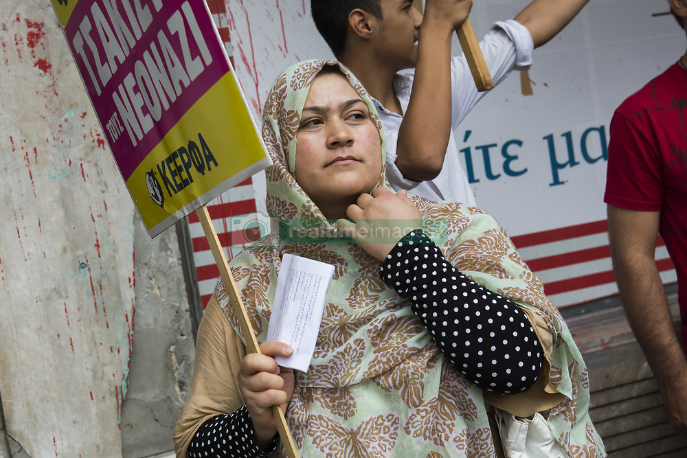 August 22, 2017 - Afghan refugees in Athens along with locals in solidarity with them gather outside the Ministry of Migration and shout slogans against the EU-Turkey deal. Afghan refugees staged a demonstration demanding to be recognized as refugees fleeing war and violence as well as an immediate halt of all deportations. (Credit Image: © Nikolas Georgiou via ZUMA Wire)