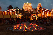 Udappuwa festival, the preparation for the fire walking. The pit is prepared. The burning wood levelled, the embers shaped into a rectangular pit.