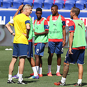Arsenal Manager Arsène Wenger talks with players at a training session at Red Bull Arena ahead of the friendly match between Arsenal and New York Red Bulls. Red Bull Arena, Harrison, New Jersey. USA. 24th July 2014. Photo Tim Clayton