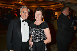 MR & MRS BRUCE RAYMOND at the 26th Cartier Racing Awards held at The Dorchester, Park Lane, London on 8th November 2016.