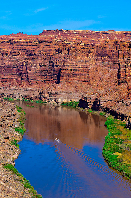 A jet boat going through the Loop,  Meander Canyon section of the Colorado River in Canyonlands National Park, Utah, USA.