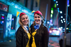 © Licensed to London News Pictures . 08/04/2017 . Manchester , UK . Two women in costume pose on Dantzic Street as a Disney themed pub crawl passes through The Printworks in Manchester City Centre . Greater Manchester Police have authorised dispersal powers and say they will ban people from the city centre for 48 hours , this evening (7th April 2017) , in order to tackle alcohol and spice abuse . Photo credit : Joel Goodman/LNP