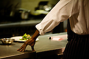 A chef rests his hand in a food preparation area in kitchens at the Vivre restaurant in Sofitel.