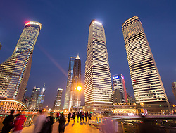 Evening view of skyscrapers in modern business district at Lujiazui in Pudong Shanghai China