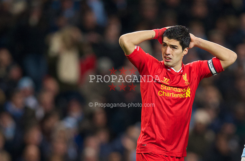 MANCHESTER, ENGLAND - Boxing Day Thursday, December 26, 2013: Liverpool's captain Luis Suarez looks dejected against Manchester City during the Premiership match at the City of Manchester Stadium. (Pic by David Rawcliffe/Propaganda)