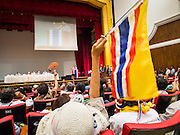 14 DECEMBER 2013 - BANGKOK, THAILAND:  A woman waves a Thai flag during an anti-government reform forum in Bangkok. The Thai anti-government movement, called the People's Democratic Reform Committee (PRDC) sponsored a forum Saturday to establish guidelines for political reform in Thailand. The opposition leader, Suther Thaugsuban, said his movement will not participate in a similar forum, sponsored by the government scheduled for Sunday. Thailand's political impasse continues with the opposition calling for the caretaker government of Prime Minister Yingluck Shinawatra to step down. Yingluck has, so far, refused to step down from her caretaker roll. Crowds at the anti-government rallies have shrunk substantially since the collapse of the government earlier in the week.       PHOTO BY JACK KURTZ