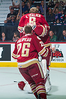 REGINA, SK - MAY 27: Olivier Galipeau #26, Samuel L'Italien #9 and Evan Fitzpatrick #31 of Acadie-Bathurst Titan celebrate the win against the Regina Pats  at Brandt Centre - Evraz Place on May 27, 2018 in Regina, Canada. (Photo by Marissa Baecker/CHL Images)