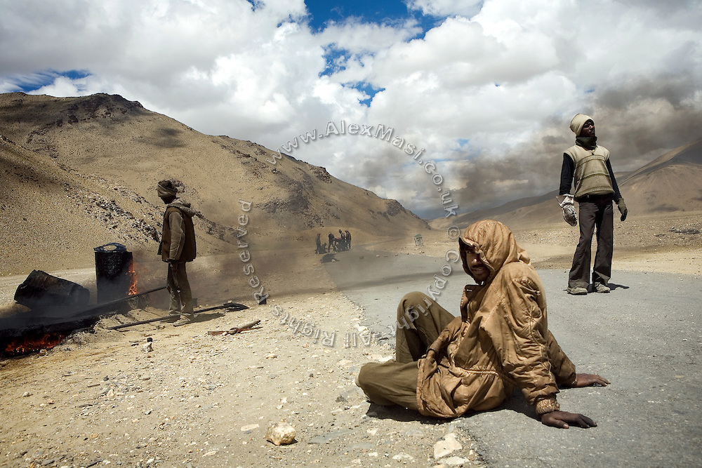 Labourers are making asphalt to repair a section of the Leh-Manali Highway.