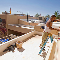 100112       Brian Leddy<br /> Miguel Hernandez Jr. helps replace a window at City Hall Monday afternoon. Hernandez works for Abeita Glass company.