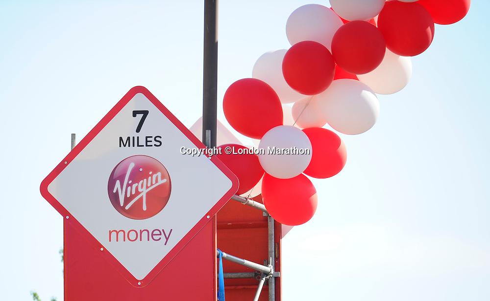 7 mile marker<br /> The Virgin Money London Marathon 2014<br /> 13 April 2014<br /> Photo: Javier Garcia/Virgin Money London Marathon<br /> media@london-marathon.co.uk