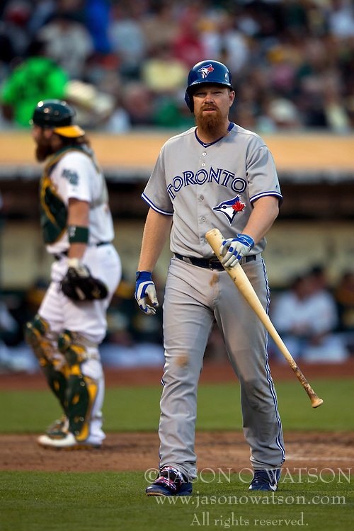 OAKLAND, CA - JULY 05:  Adam Lind #26 of the Toronto Blue Jays returns to the dugout after striking out against the Oakland Athletics during the fourth inning at O.co Coliseum on July 5, 2014 in Oakland, California. The Oakland Athletics defeated the Toronto Blue Jays 5-1.  (Photo by Jason O. Watson/Getty Images) *** Local Caption *** Adam Lind
