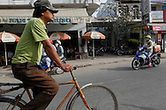Street scene in the town of Tan Chau  along the Mekong River in Vietnam<br /> <br />  photo by Dennis Brack