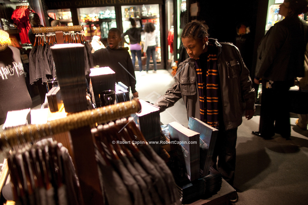 """Kids look at merchandise in the gift shop at the """"Harry Potter"""" exhibition at Discovery Times in New York. ..Photo by Robert Caplin."""
