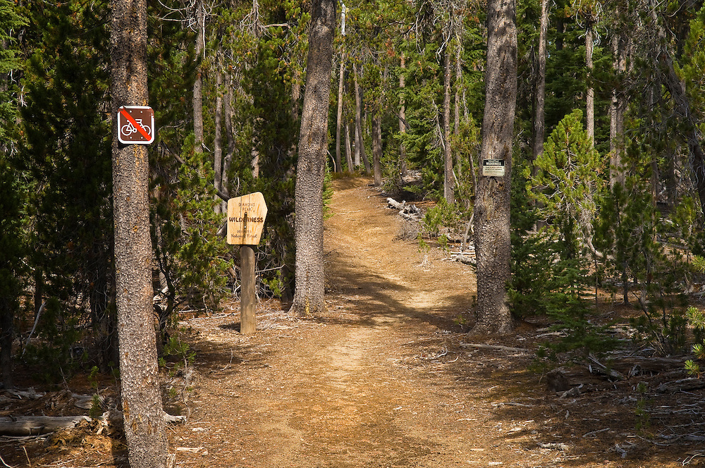 Pacific Crest Trail at Summit Lake, entering Diamond Peak Wilderness; Cascade Mountains, Oregon, with Wilderness and No Bikes signs