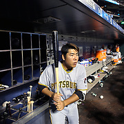 NEW YORK, NEW YORK - June 16: Jung Ho Kang #27 of the Pittsburgh Pirates in the dugout preparing to bat during the Pittsburgh Pirates Vs New York Mets regular season MLB game at Citi Field on June 16, 2016 in New York City. (Photo by Tim Clayton/Corbis via Getty Images)