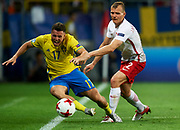 Lublin, Poland - 2017 June 19: (R) Pawel Jaroszynski from Poland U21 fights for the ball with (L) Kerim Mrabti from Sweden U21 while Poland v Sweden match during 2017 UEFA European Under-21 Championship at Lublin Arena on June 19, 2017 in Lublin, Poland.<br /> <br /> Mandatory credit:<br /> Photo by &copy; Adam Nurkiewicz / Mediasport<br /> <br /> Adam Nurkiewicz declares that he has no rights to the image of people at the photographs of his authorship.<br /> <br /> Picture also available in RAW (NEF) or TIFF format on special request.<br /> <br /> Any editorial, commercial or promotional use requires written permission from the author of image.