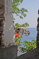 Looking through the portals at the Goa Giri Putri cave temple on Nusa Penida, Bali, Indonesia