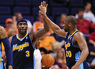 Mar. 10, 2011; Phoenix, AZ, USA; Denver Nuggets guard Ty Lawson (3) is congratulated by teammate guard Raymond Felton (20) while playing against the Phoenix Suns at the US Airways Center. The Nuggets defeated the Suns 116-97.  Mandatory Credit: Jennifer Stewart-US PRESSWIRE