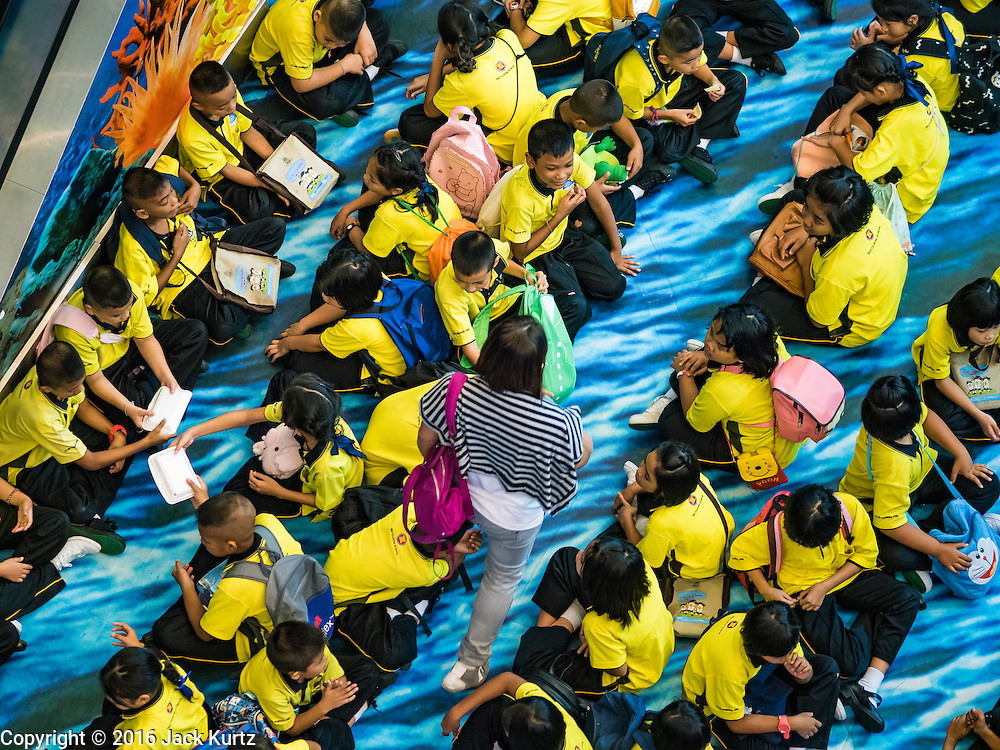14 JUNE 2016 - BANGKOK, THAILAND:  Students wait to go into a show at Siam Ocean World, an aquarium in the basement of Siam Paragon Mall.      PHOTO BY JACK KURTZ