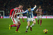 Huddersfield Town Midfielder Joe Lolley holds back Stoke City Defender Tom Edwards during the Premier League match between Huddersfield Town and Stoke City at the John Smiths Stadium, Huddersfield, England on 26 December 2017. Photo by Craig Zadoroznyj.