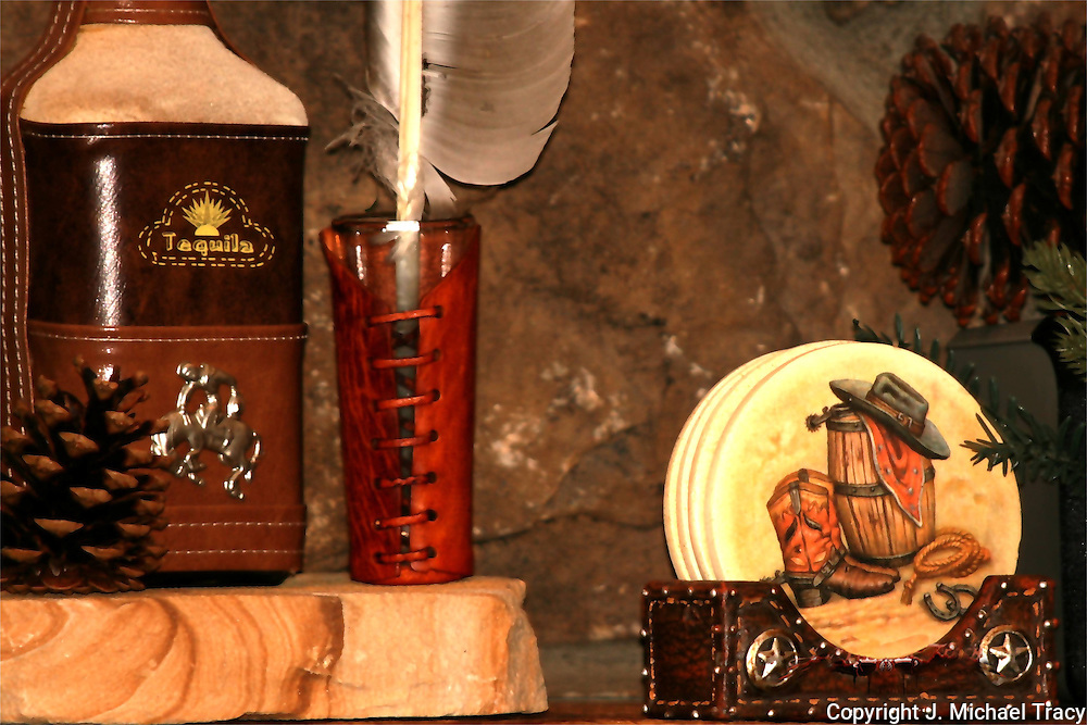 Leatherbound Taquilla Bottle and shot glass with Western themed coasters and holder, still life.