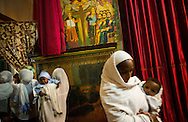 Worshippers enter the women's area of Maryam (St. Mary's) Church in the Entoto Natural Park in Addis Ababa, Ethiopia, November 10, 2013.