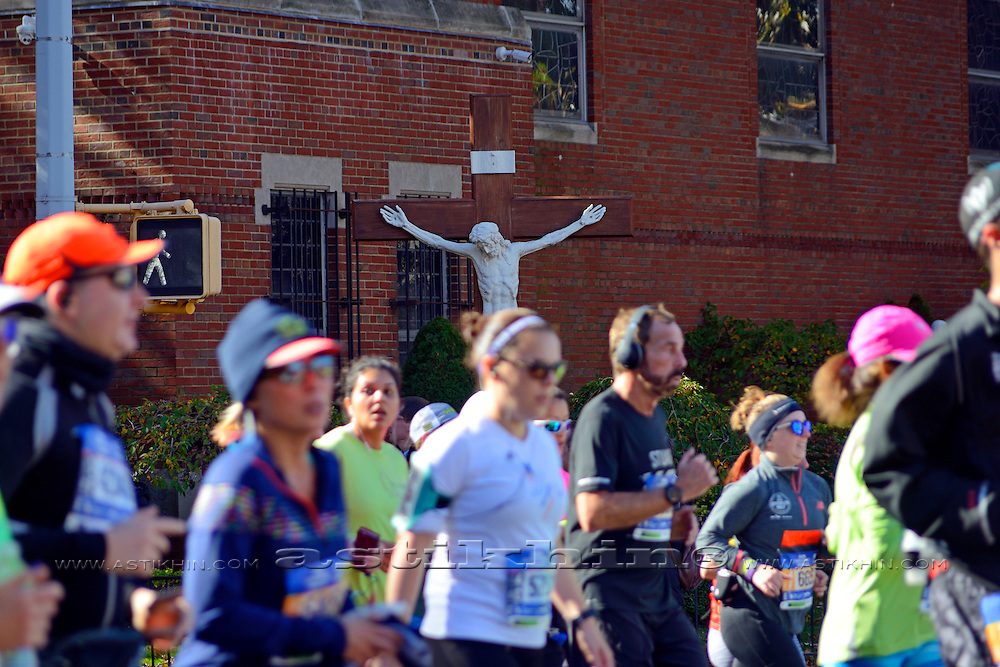 Jesus Christ on the Cross and NYC Marathon runners.
