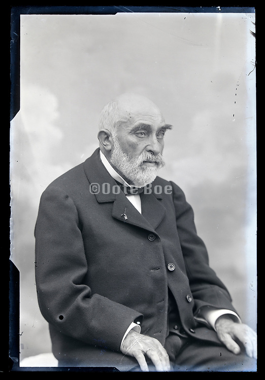 studio portrait of an elderly man with beard and  mustache France circa 1920s