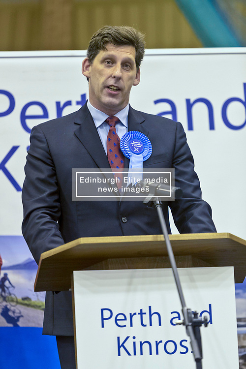 The count for the UK Parliamentary General Election 2017 for the Perth & North Perthshire Constituency takes place at Bell's Sports Centre in Perth.<br /> <br /> The four candidates standing for the seat are Peter Barrett (Scottish Liberal Democrats), Ian Duncan (Scottish Conservatives), David Roemmele (Scottish Labour) and Pete Wishart (SNP)<br /> <br /> Pictured: After two re-counts the result of Perth and North Perthshire is announced with Pete Wishart retaining the seat with 21,804 votes. Ian Duncan (Conservative) trailed by 21 votes with 21,783. David Roemmele (Labour) third with 5,349 and Peter Barrett (Liberal Democrats) fourth with 2,589 - Ian Duncan concedes to Pete Wishart by 21 votes